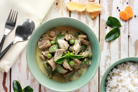 thai food: portrait of thai green curry served with rice