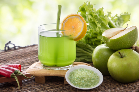 natural health: a potrait of a glass apple and green vegetables mix into a refreshing juice