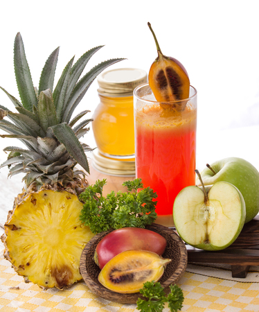 pineapple  glass: A potrait of a glass juice combinating tamarillo and pineapple Stock Photo
