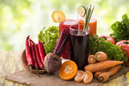 A potrait of  beet, carrot, and chili pepper mix juice photo