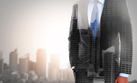 concept of double exposure businessman and city photo