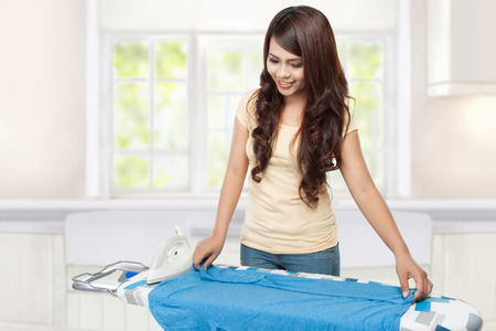 clean clothes: asian woman doing the laundry at home Stock Photo
