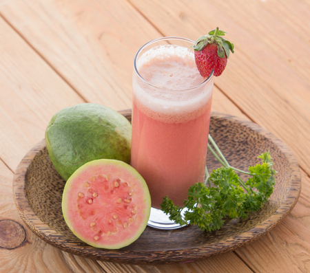 guava: A potrait of a glass of Guava Smoothie Stock Photo