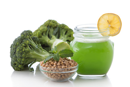 mixed fruits: a potrait of a glass broccoli and soy mix into a refreshing smoothie