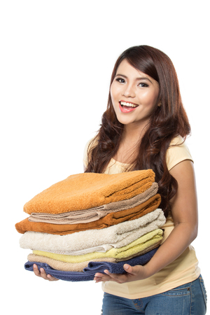 household tasks: woman doing a housework holding laundry