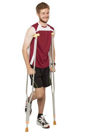 Young man isolated on white background having injury while exercising photo
