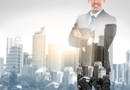 handsome business man double exposure concept of businessman and city photo