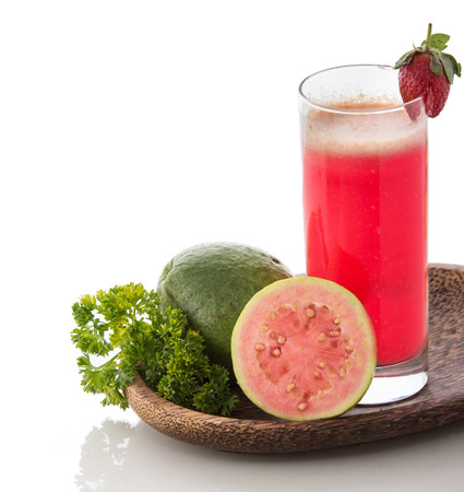 A potrait of a glass of Guava Smoothie photo