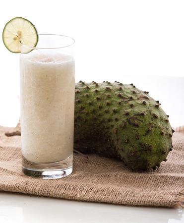 A potrait of a glass  soursop juice