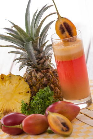 tamarillo: A potrait of a glass juice combinating tamarillo and pineapple Stock Photo