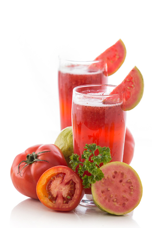 A potrait of a glass of Tomato and Guava mix smoothie photo