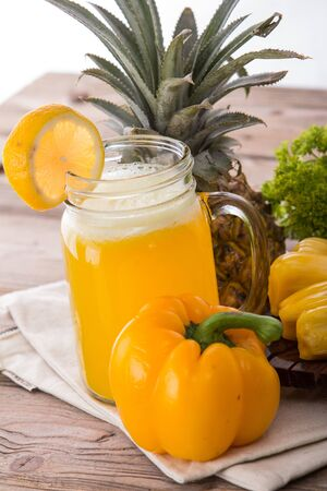 combining: A smoothie combining of yellow paprika, jackfruit, and pineapple Stock Photo