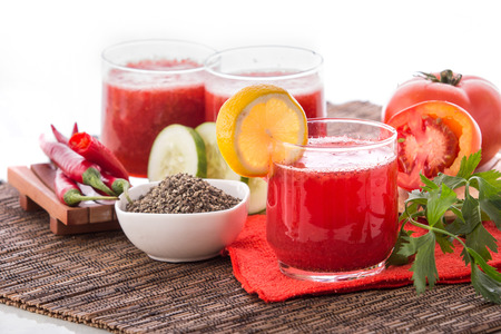 A potrait of a glass mix of Red Vegetables and herbs Smoothie photo