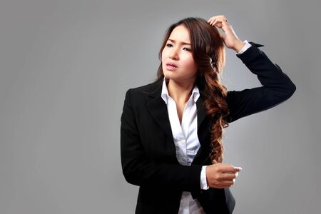 A portrait of a young businesswoman confuse, stressed