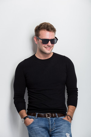 A portrait of a young man smile with sunglasses on photo