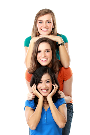 happy teenagers: Portrait of three happy teenagers lined up and having fun