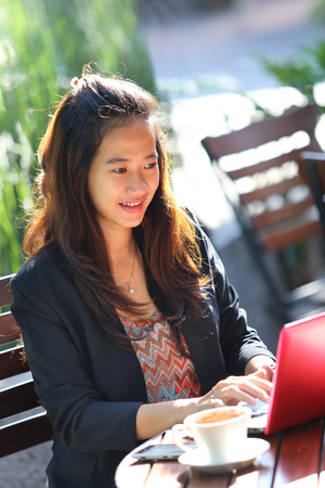 oudoor: A portrait of a Young businesswoman work oudoor, in a cafe