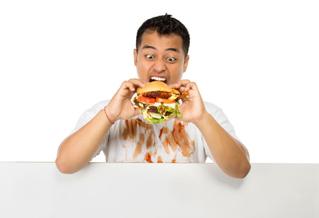 big mouth: A portrait of young man have a great desire to eat a burger Stock Photo