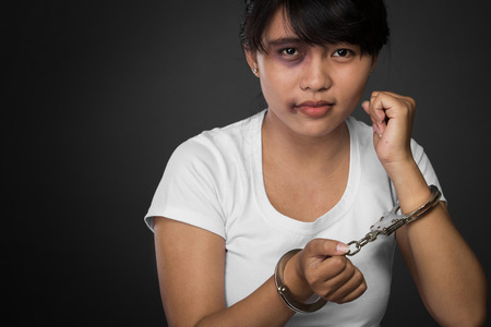 threaten: A portrait of a woman with hands cuffed being abused,   struggle, terrified,  and threaten from domestic violence and abuse