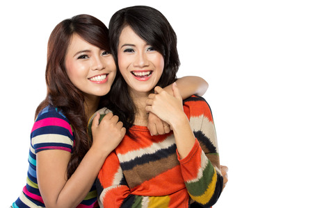 A portrait of two girls in a happy friendship, smile brightly