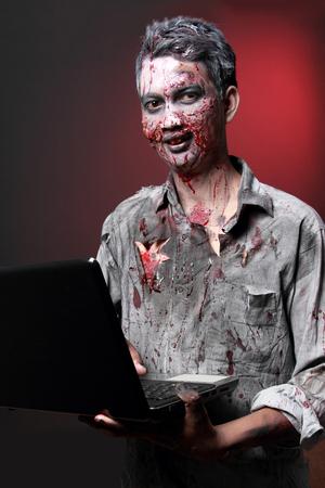 maniac: Zombie computer maniac looking camera write email
