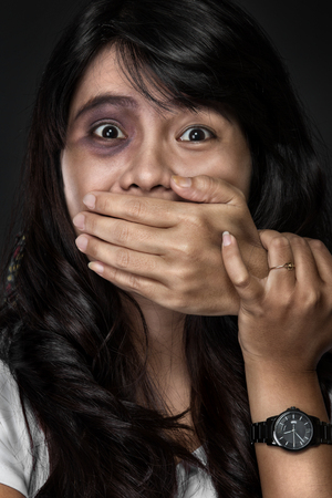 A portrait of the fear of woman victim of domestic violence and abuse photo