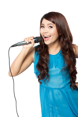 A portrait of a young woman sing holding a mic, isolated white background Stock Photo - 38305185