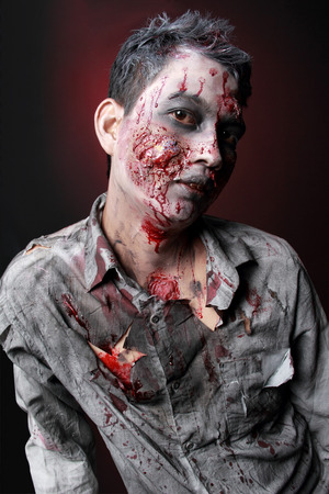 Zombie standing  looking camera close up face photo