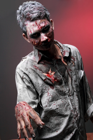 portrait of a Zombie standing looking camera face scaried photo