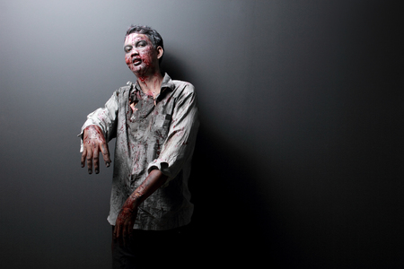 portrait of a Zombie standing with black background photo