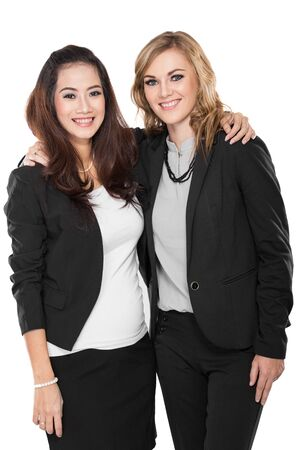 blazer: A portrait of two young businesswoman in a friendly hug, isolated Stock Photo