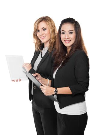 A portrait of a two young businesswoman discuss with a clipboard, isolated photo