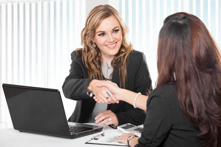 agree: A portrait of a Two young businesswoman shaking hand Stock Photo