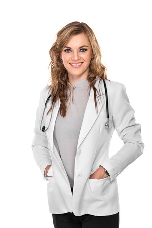 A portrait of a Smiling young female doctor with hands on the pocket, isolated photo