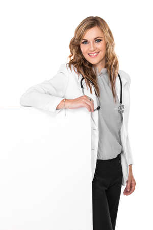 doctor holding gift: A portrait of a smiling female doctor with stethoscope and white blank board, isolated
