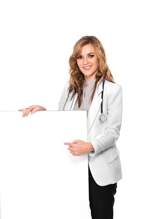 A portrait of a smiling female doctor with stethoscope and white blank board, isolated photo