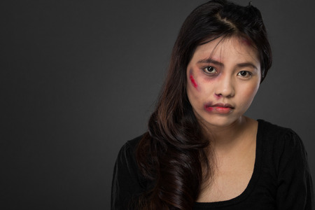 portrait of a asian woman victim of domestic abuse