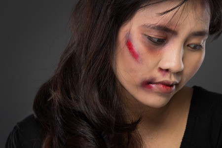 torture: portrait of a asian woman victim of domestic abuse