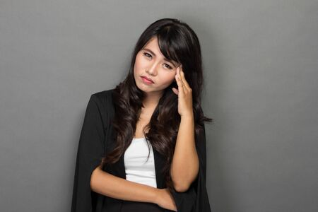 portrait of Asian business woman feeling stressed photo