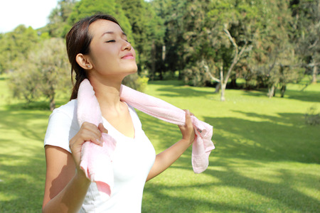 fresh air: portrait of sporty woman feel relax and happy under the sunshine at park with fresh air