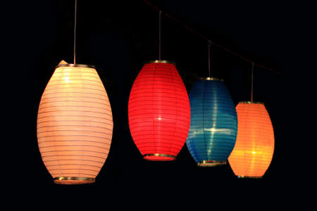 portrait of colorful paper lanterns isolated in black photo