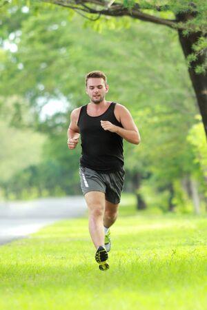 weight loss man: full length portrait of male runner training for marathon