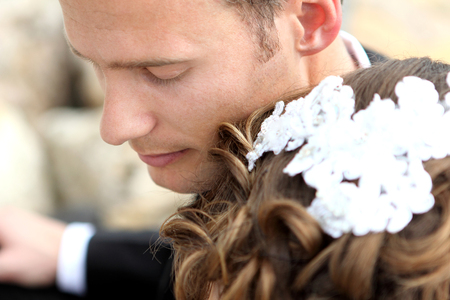 close up eyes: close up portrait of handsome groom with eyes closed