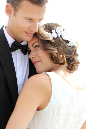 portrait of bride and groom embrace each other