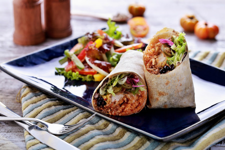 portrait of mexican burritos prawn queiro served with mango salsa photo