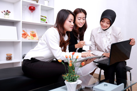 portrait of group of young businesswomen talking about future plan Stock Photo