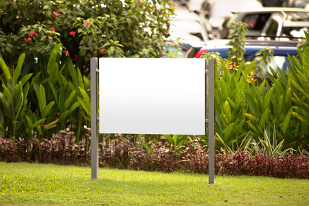 billboard: A portrait of a blank billboard for advertisement in the garden