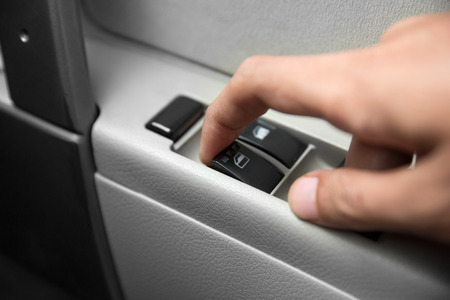 lift lock: A portrait of windows controls and adjustments. Car window controls Stock Photo