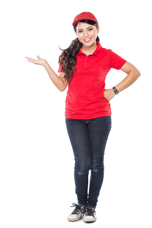 A portrait of a delivery young asian woman presenting to copyspace isolated in white background Stock Photo