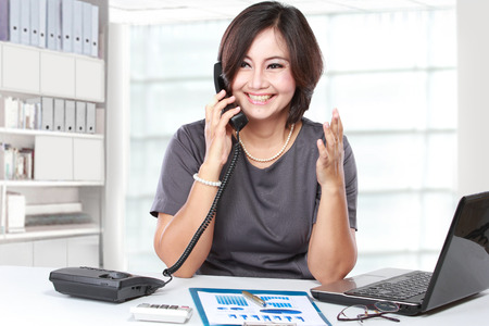 phone professional: Portrait of businesswoman working and calling by phone Stock Photo